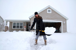 shoveling snow at house