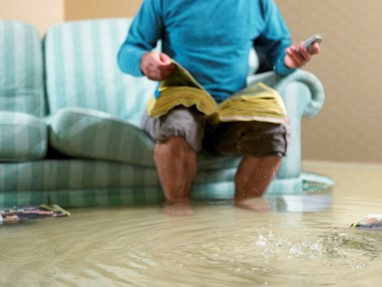 person in flooded house